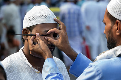 Muslim men have their eyes painted for Eid al-Adha, Red Road, Madian, Kolkata, India. I have the only photos taken by a forei...