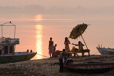 Boats and umbrellas at sunrise on the Ganges, Assi Ghat, Varanasi, India
