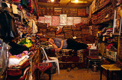 Syria - Aleppo - A man asleep inside his shop