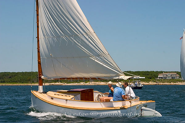 Rugosa passes through the start at the Squeteague harbor catboat Association rendezvous