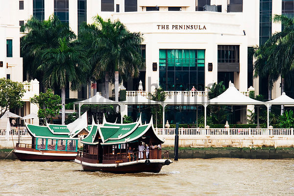 River Taxis Crossing Chao Phraya River from Peninsula Hotel, Bangkok, Thailand