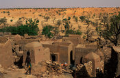 Cliff village built on the slopes of the Bandiagara escarpment, view over desert plains, Tireli, Dogon Country, Mali