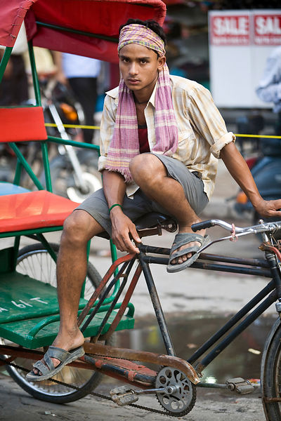 India - Delhi - A young rickshaw wallah rests on Chadni Chowk