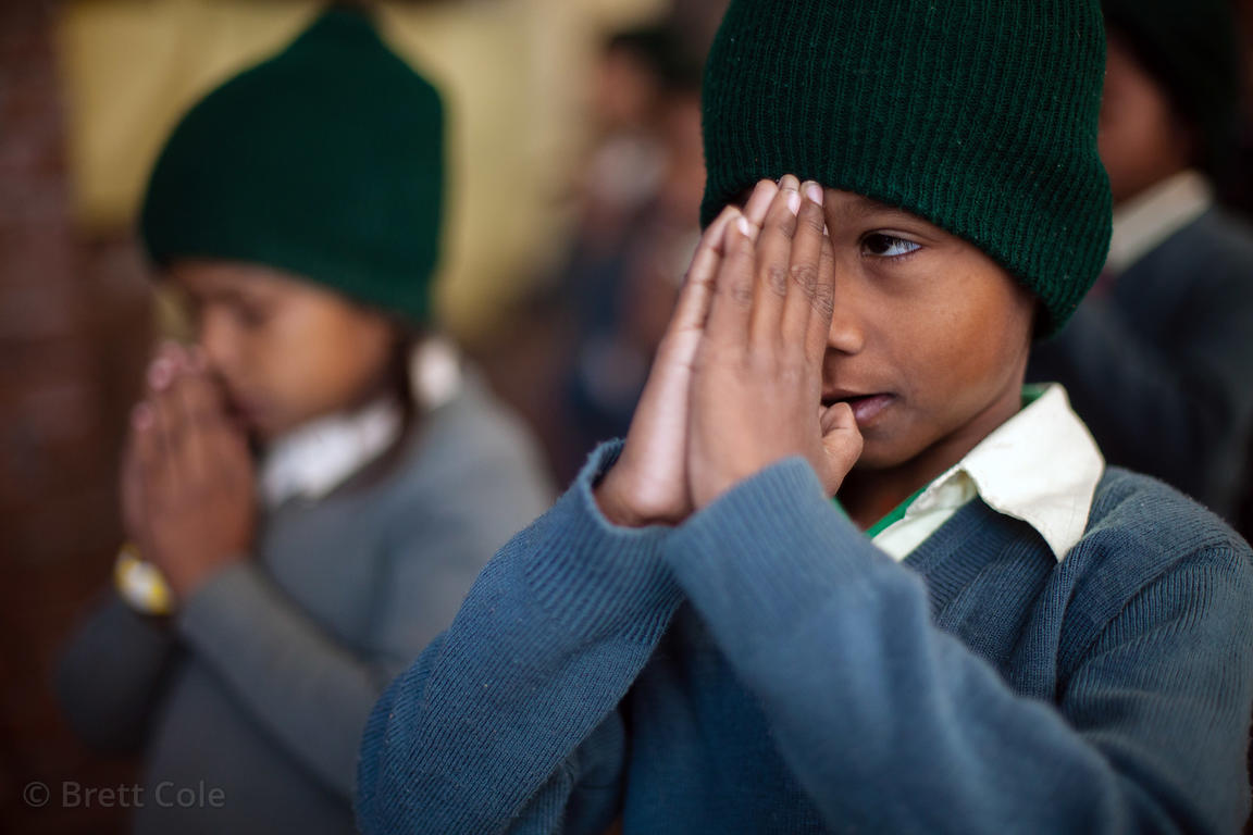 Children pray at a school in Varanasi, India operated by the Dutch NGO Duniya (duniya.org)