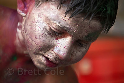 Boy with his face painted silver during the Holi festival, Pushkar, Rajasthan, India