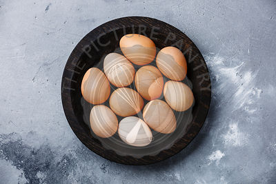 Guinea-fowl eggs on concrete background
