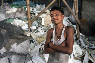A boy recycles plastic refrigerator trays, Dhapa, Kolkata, India. Dhapa is a large industrial zone that processes most of Kol...