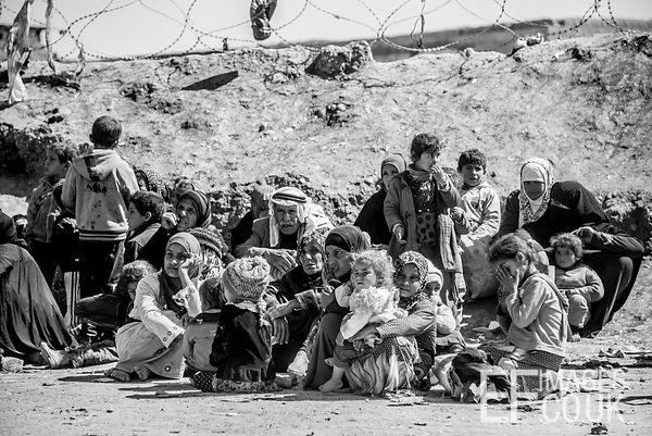 People Displaced By The ISIS Conflict Wait To Be Accommodated At Hamam al Alil Camp Having Escaped From Mosul. Unfortunately ...