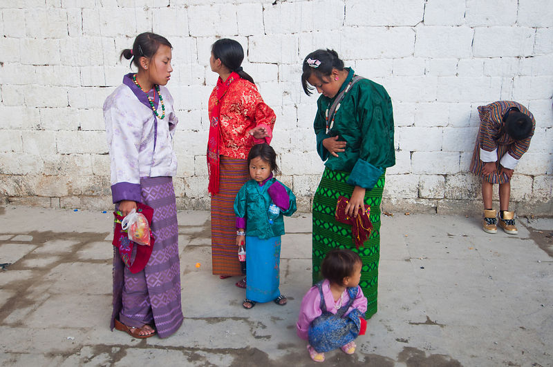 A group of mothers chat during the Thimphu festival, Bhutan