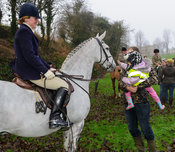 A young supporter is introduced to Maz Medcalf's horse - The Cottesmore Hunt's Boxing Day meet 2013.