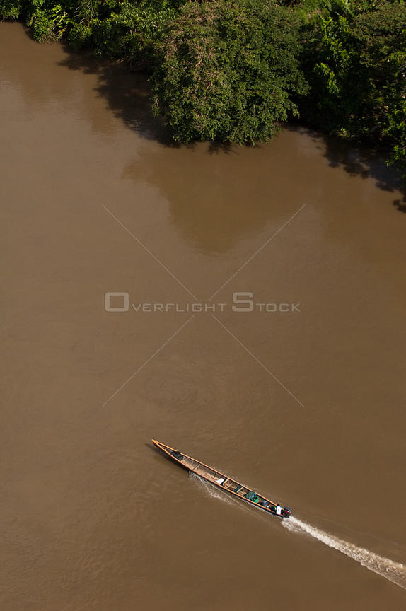 Motor canoe on the Aguarico River in Cuyabeno Reserve seen from the air. Ecuador, June 2007.