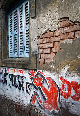 Communist party logo painted on a wall in Bowbazar, Kolkata, India.