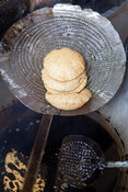 India - Delhi - Nagori (small puris) frying in oil at Ram Swarup a shop which has been  serving up breakfasts in the old city...