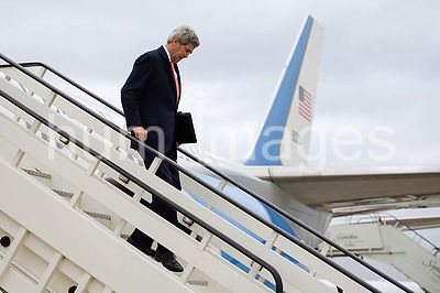 U.S. Secretary of State John Kerry steps off his airplane at Heathrow Airport in London, U.K., on March 21, 2015, for a meeti...