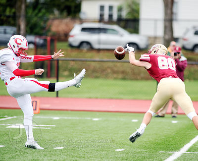 Coe College's Trevor Noble (80) blocks a punt by Central's Tyler Brandt (45) that was downed for a safety during the first ha...