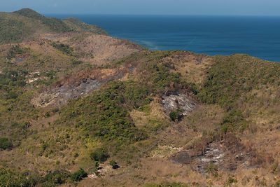 Aerial view showing slash and burned patches of barren land amidst other cultivated vegetation. Philippines, April 2010