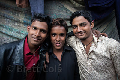Brothers in a slum area in Ward 66, Muchipara, Kolkata, India. Many people in the community make sandals.