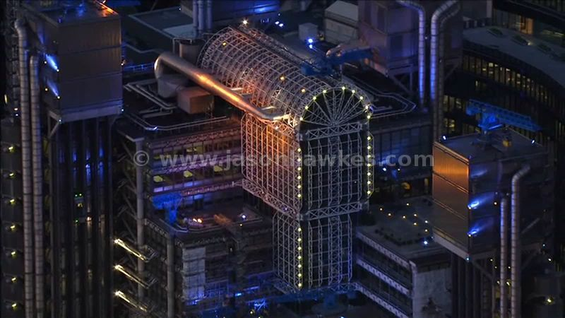 Aerial footage over the Lloyd's Building at night, City of London, UK, England
