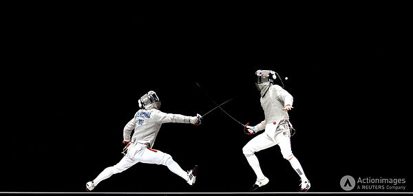 Olympics - London 2012 Olympic Games - ExCel - 3/8/12 Fencing - Men's Team Sabre - Final - Romania's Florin Zalomir (L) in ac...