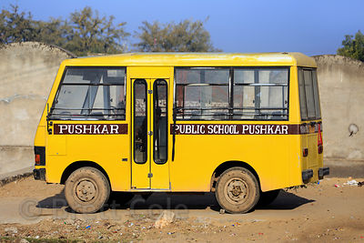 Cute little yellow bus in Nedaliya, Rajasthan, India