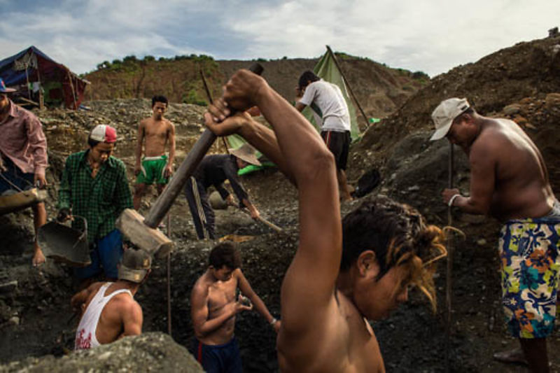 A team of small-scale miners work in a jade mine, Hpakant, Kachin State, Myanmar, July 18, 2014. Some miners work alone while...