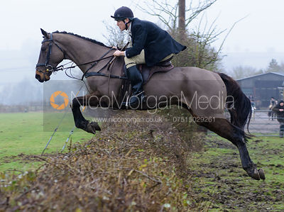 Rory Bevin jumping a hedge at Town Park Farm