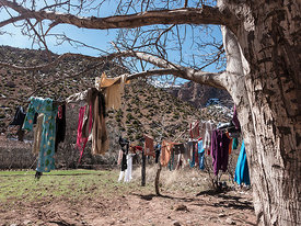 Women in the Atlas wash clothes all day long - in the icy water of the rivers and dry them in the  landscape.