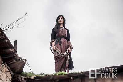 A Beautiful Kurdish Woman Stands Atop A Roof To Watch The Newroz Celebrations In Akre