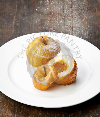 Baked apple with honey on wooden background