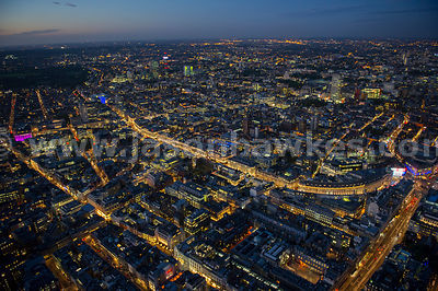 Aerial view of Westminster and Soho at night, London
