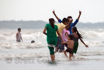 A family having fun at Juhu Beach, Mumbai, India.