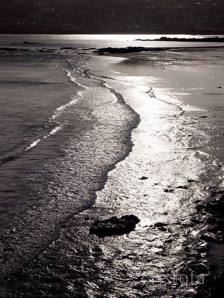 silver light on wet sand on the Penzance seafront