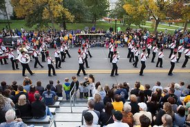 The City High Marching Band passes by on Clinton St during the  University of Iowa homecoming Parade in Iowa City on Friday S...
