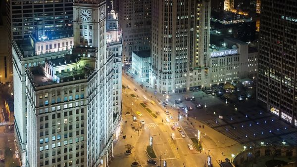 Bird's Eye: Wide Shot of A Pulsating Michigan Avenue Below the Historic Wrigley Clock Tower at Night