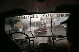 Malagasy firefighters drive around for emergency calls during tropical cyclone Enawo in Antananarivo, Madagascar, on March 8,...