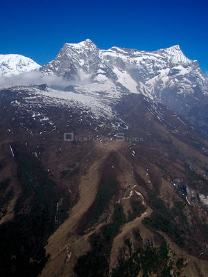 NEPAL Mount Nupla -- 16 Apr 2005 -- Aerial photograph of Mount Nupla, which is 5,885m high and dominates the view from nearby...