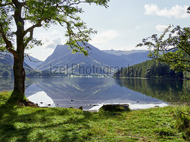 Views of Fleetwith Pike from the shore of Lake Buttermere in the English Lake District on a summers day, UK.