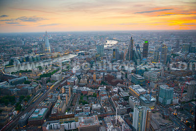 Aerial view over The City at dusk looking West, London