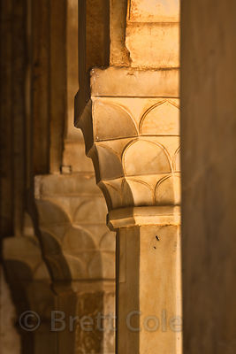 Sandstone columns bathed in morning light in Amber Fort, Jaipur, Rajasthan, India