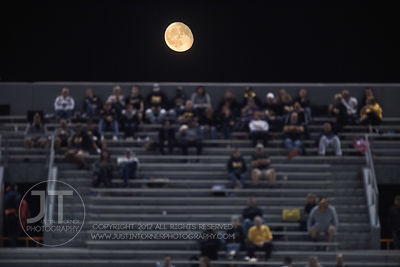 The moon rises over the Bettendorf fans during the second half of play versus Cedar Rapids Washington at Kingston Stadium in ...