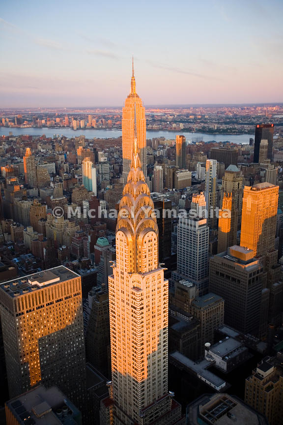 The 102-story Empire State Building and the 77-story Chrysler Building, here perfectly aligned, are Art Deco icons in Manhatt...