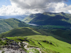 Summits of High Crag, High Stile and Red Pike above Buttermere from below Whitless Pike on a sunny day in the English Lake Di...