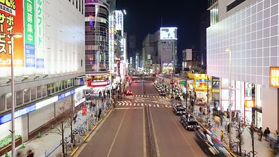 Wide Shot: White Lights, Sidewalks, & Streets Of Shinjuku
