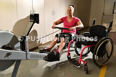 Young woman using a rowing machine in a rehabilitation gym