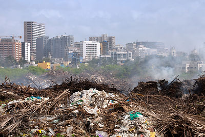 Garbage burns on South Juhu Beach in Mumbai, India. Mumbai's landfills are nearly full, with the massive Deonar dump holding ...