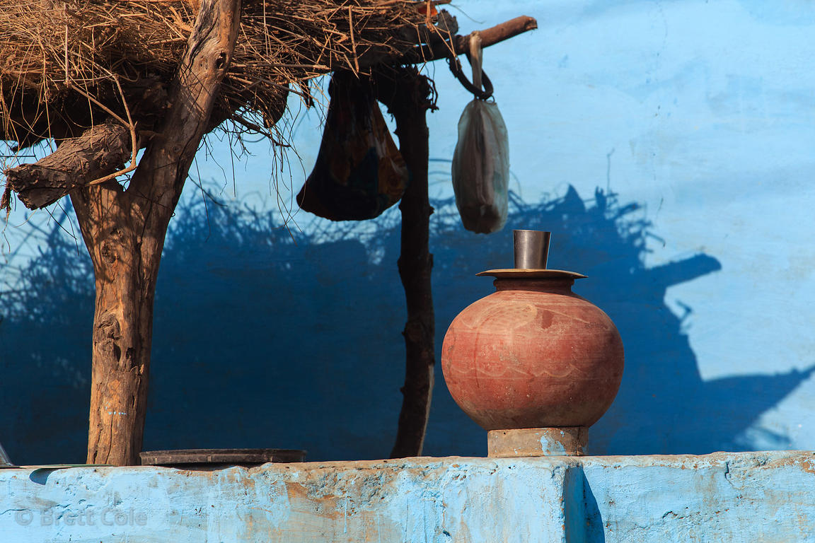 Clay water pot against a blue wall, Nedaliya village, Pushkar, Rajasthan, India