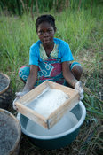 Woman sifting maize to make nsima, Chintheche, Malawi