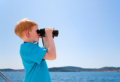 Croatia, Zadar, Boy looking through an binocular