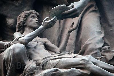 Detail of a statue showing an emaciated man near Victoria Memorial, Kolkata, India.