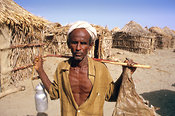 A man from the Afar ethnic group carries a butter container and a goat skin in Bada village, situated in the Danakil desert, in south-eastern Eritrea.